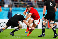 1st November 2019, Tokyo, Japan;  Dillon Lewis (WAL) hands off a tackle from Brodie Retallick of New Zealand; 2019 Rugby World Cup 3rd place match between New Zealand 40-17 Wales at Tokyo Stadium in Tokyo, Japan.  - Editorial Use