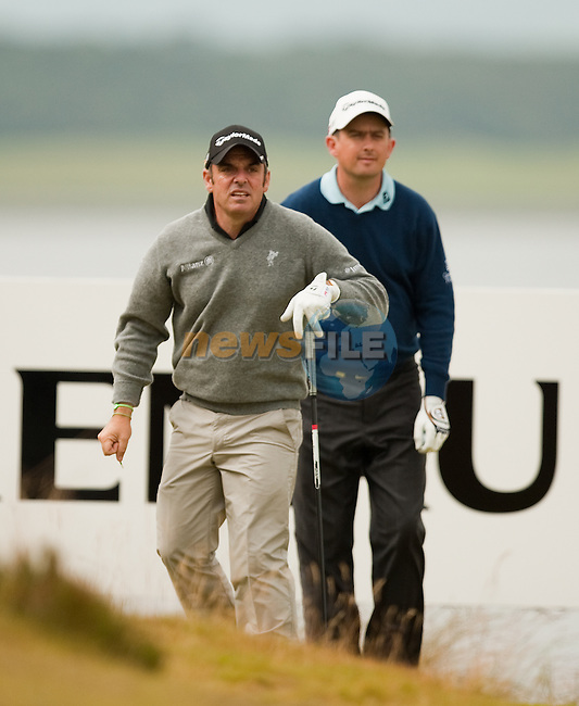 Paul McGinely and Peter Lawrie watch a drive at the 12th hole during the final round  of the Barclays Scottish Open, played over the links at Castle Stuart, Inverness, Scotland from 7th to 10th July 2011:  Picture Stuart Adams /www.golffile.ie 10th July 2011