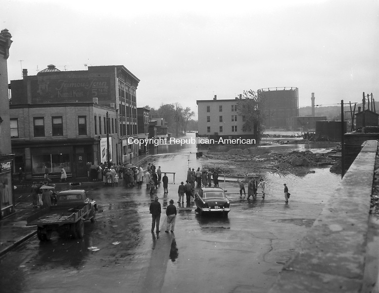 Local folks assess damage in the Bank Street area of Waterbury after the flood of August 1955.