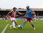 Billy Sharp of Sheffield Utd tussles with David Mirfin of Scunthorpe Utd during the English League One match at Glanford Park Stadium, Scunthorpe. Picture date: September 24th, 2016. Pic Simon Bellis/Sportimage