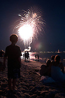 Young boy watches fireworks display at historic Naples Fishing Pier along Gulf of Mexico, Naples, Florida, USA, July 4, 2011. Photo by Debi Pittman Wilkey