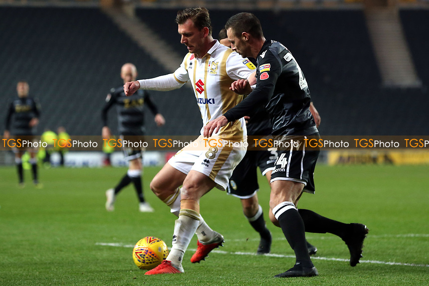 Alex Gilbey of MK Dons and Michael Rose of Macclesfield Town during MK Dons vs Macclesfield Town, Sky Bet EFL League 2 Football at stadium:mk on 17th November 2018