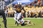 Minnesota Golden Gophers running back Donnell Kirkwood (20) in action during the Texas Bowl game between the Syracuse Orange and the Minnesota Golden Gophers at the Reliant Stadium in Houston, Texas. Syracuse leads Minnesota 7 to 3 at halftime.