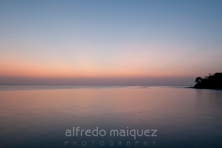 Lagoon and horizon at dusk in Pacheca Island. Las Perlas Archipelago, Panama province, Central America.