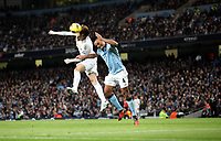 Barclays Premier League, Man City (blue) V Swansea City (white) Etihad Stadium, 27/10812<br /> Pictured: Michu beats Kompany to the high ball<br /> Picture by: Ben Wyeth / Athena Picture Agency
