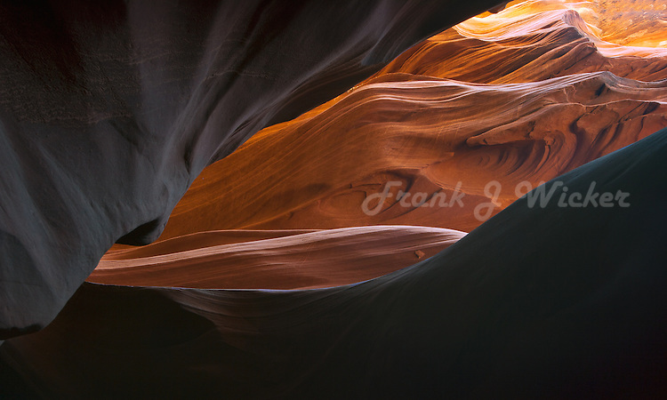 Colorful flowing waves of sandstone erosion enhance the beauty and visual impact of the sculptures created by the forces of nature in the Antelope slot canyon of the Southwest desert near Lake Powell and Page Arizona