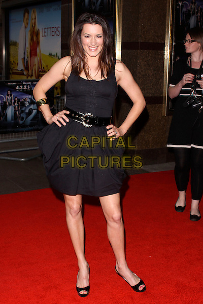 KATE MAGOWAN .World Film Premiere of '4,3,2,1' at the Empire, Leicester Square, London, England, UK, May 25th 2010 4321 4-3-2-1 arrivals full length dress waist belt peep toe shoes hands on hips  black smiling .CAP/AH.©Adam Houghton/Capital Pictures.
