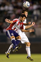 Chivas USA midfielder Paulo Nagamura battles with DC United midfielder Branko Boskovic. CD Chivas USA beat DC United 1-0 at Home Depot Center stadium in Carson, California on Sunday August 29, 2010.
