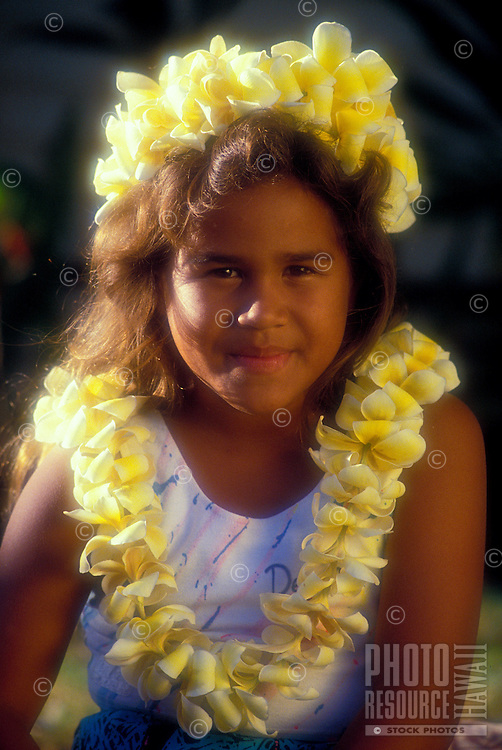Beautiful young girl dressed up in leis
