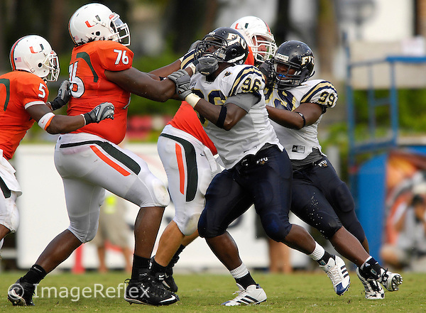 Florida International University Golden Panthers (0-2, 0-0 SBC)  versus the University of Miami Hurricanes (1-1, 0-0 ACC) at the Orange Bowl, Miami, Florida on Saturday, September 15, 2007.  The Hurricanes defeated the Golden Panthers, 23-9...Late in the second quarter, FIU junior defensive back Jarvis Penerton (96) (Homestead, Fla.) attempts to get around Miami offensive lineman Chris Rutledge (76), despite Rutledge holding on to Penerton's face mask.