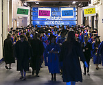 Students make their way toward their seats at the Allstate Arena Sunday, June 11, 2017, before the DePaul University College of Science and Health and College of Liberal Arts and Social Sciences commencement ceremony in Rosemont, IL. (DePaul University/Jamie Moncrief)