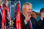 Wales's national rugby team who won both the Six Nations and the Grand Slam are welcomed to the National Assembly for Wales Senedd building in Cardiff Bay today for a public celebration event. Coach Warren Gatland waves to fans during the event.