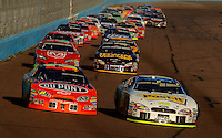 Nov 13, 2005; Phoenix, Ariz, USA;  Nascar Nextel Cup drivers Jeff Gordon and Greg Biffle lead the field on a restart during the Checker Auto Parts 500 at Phoenix International Raceway. Mandatory Credit: Photo By Mark J. Rebilas