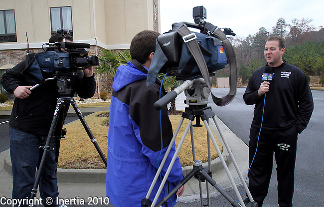 ROME, GA - DECEMBER 16: Sioux Falls television reporters interview University of Sioux Falls Head Coach Jed Stugart outside their hotel Thursday afternoon prior to practice for the NAIA Football Championship game coming up this Saturday afternoon. (photo by Dave Eggen/Inertia)