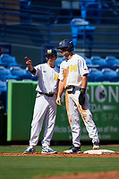 Michigan Wolverines assistant head coach Nick Schnabel (23) talks with Jonathan Engelmann (2) during a game against Army West Point on February 18, 2018 at Tradition Field in St. Lucie, Florida.  Michigan defeated Army 7-3.  (Mike Janes/Four Seam Images)
