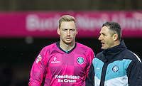 Goalkeeper Ryan Allsop of Wycombe Wanderers chats to Barry Richardson of Wycombe Wanderers during the Sky Bet League 2 match between Wycombe Wanderers and Luton Town at Adams Park, High Wycombe, England on 6 February 2016. Photo by Andy Rowland.