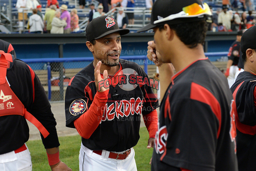 Batavia Muckdogs manager Angel Espada (4) high fives his players after a game against the Auburn Doubledays on August 31, 2014 at Dwyer Stadium in Batavia, New York.  Batavia defeated Auburn 7-6.  (Mike Janes/Four Seam Images)