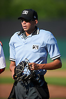 Umpire Emil Jimenez during a game between the Williamsport Crosscutters and Auburn Doubledays on June 26, 2016 at Falcon Park in Auburn, New York.  Auburn defeated Williamsport 3-1.  (Mike Janes/Four Seam Images)