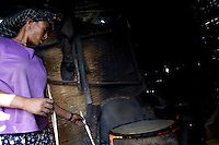 Mulu, 30 years old, living with HIV and mother of two children, bakes njera, a traditional ethiopian pan cake made out of tef and at the base of ethiopian diet, next to her compound as part of an income generating activity supported by the american NGO Save the Children US along the high risk corridor  in Dukam, close to Debre Zheit, Ethiopia on tusday March 10 2009..Save the Children US manages a vaste rrange of activities in support of vulnarable people that live along the truck route that connects Addis Ababa, Ethiopia's capital to the port of Djibouti. Ethiopia, a land locked country depends on the Djibouti port for most of its imports and exports.