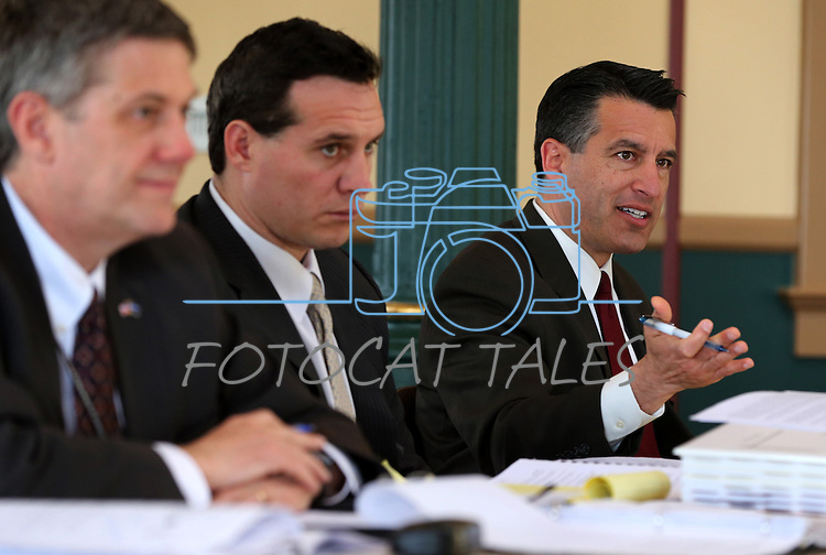 From left, state prison director Greg Cox, Secretary of State Ross Miller and Gov. Brian Sandoval work in a meeting of the Board of State Prison Commissioners at the Capitol in Carson City, Nev., on Tuesday, March 19, 2013..Photo by Cathleen Allison