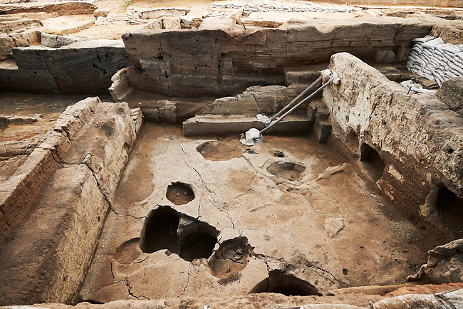Building 321. Empty burial pit in the floor of the Neolithic remains of mud brick house. In the top right is a darker area which was the midden or refuse pile from the house, 7500 BC to 5700 BC. North ecavation area, Catalyhoyuk Archaeological Site, Çumra, Konya, Turkey