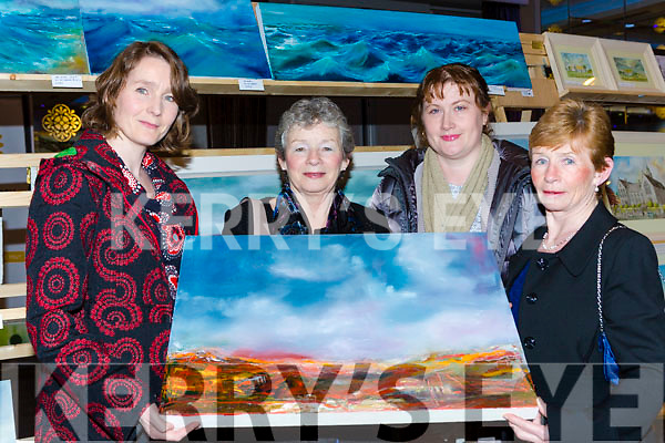 Artist Lynda Horgan Gneeveguilla shows l-r: Carmel Horgan, Mary McCarthy and Maria Foley at the Killarney Rotary club Wine and Art night in the Malton Hotel on Thursday night