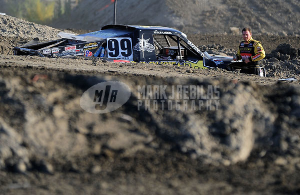 Dec. 19, 2009; Lake Elsinore, CA, USA; LOORRS unlimited four driver Kyle LeDuc stands by his truck after breaking during the Lucas Oil Challenge Cup at the Lake Elsinore Motorsports Complex. Mandatory Credit: Mark J. Rebilas-US PRESSWIRE