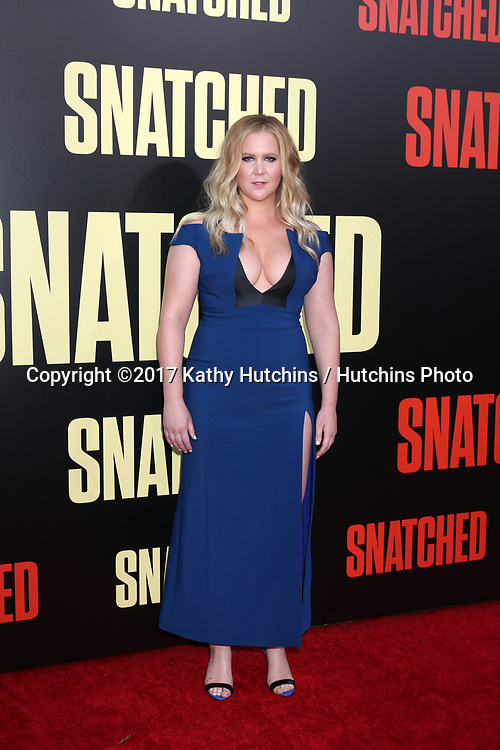 "LOS ANGELES - MAY 10:  Amy Schumer at the ""Snatched"" World Premiere at the Village Theater on May 10, 2017 in Westwood, CA"
