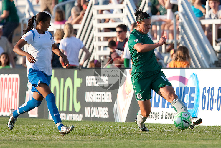 August 1 2009           Athletica's Melissa Tancredi (14, at right) keeps the ball in bounds as she's pursued by Breakers player Fabiana (15, left) in the first half.   The St. Louis Athletica of the Women's Professional Soccer league hosted the Boston Breakers on Saturday August 1, 2009 at the Anheuser Busch Soccer Park in Fenton, Missouri.   The Athletica won, 1-0, and clinched a spot in the post-season playoffs...            *******EDITORIAL USE ONLY*******