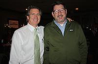NWA Democrat-Gazette/CARIN SCHOPPMEYER Scott Bailey (left) and Tim McFarland help support Restore Humanity on Nov. 30.