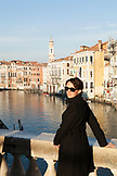ITALY, Venice. Artist Mia Kaplan on the Rialto Bridge overlooing the Grand Canal.