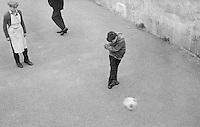 Football in the playground, Whitworth Comprehensive School, Whitworth, Lancashire.  1970.