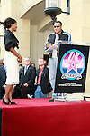 Laurence Fishburne attends a ceremony where actress Angela Bassett receives a star on the Hollywood Walk of Fame in Los Angeles, California on March 20, 2008. Photopro.