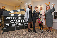 Pictured: Lottery winners and Tina Burgess, 55 (L) and Karen Maddock 51 (R) welcome guests as they arrive. Wednesday 28 November 2018<br /> Re: National Lottery millionaires from south Wales and the south west of England have hosted a glitzy Rat Pack-inspired Christmas party for an older people's music group at The Bear Hotel in Cowbridge, Wales, UK.