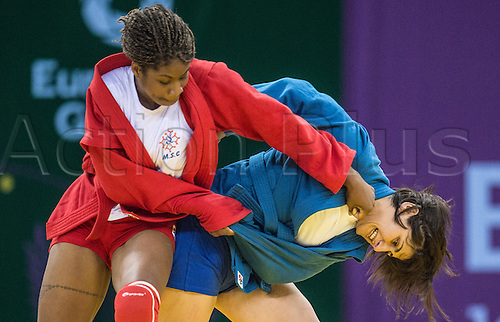 22.06.2015. Baku, Azerbaijan. 1st European Games. Celine Conde of France (red) fights against Tea Sukhitashvili (blue) of Georgia during the Women's -68 kg 1/8 final competition in Sambo at the Baku 2015 European Games in Baku, Azerbaijan