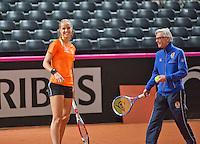 Februari 04, 2015, Apeldoorn, Omnisport, Fed Cup, Netherlands-Slovakia, Training Dutch team, Arantxa Rus with coach Martin Bohm<br /> Photo: Tennisimages/Henk Koster