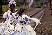 Baianas on the way to the Samba Schools Parade walking on the railway, Carnival, Rio de Janeiro, Brazil.
