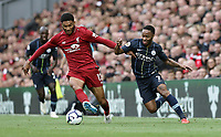 Liverpool's Joe Gomez holds off the challenge from Manchester City's Raheem Sterling <br /> <br /> Photographer Rich Linley/CameraSport<br /> <br /> The Premier League - Liverpool v Manchester City - Sunday 7th October 2018 - Anfield - Liverpool<br /> <br /> World Copyright &copy; 2018 CameraSport. All rights reserved. 43 Linden Ave. Countesthorpe. Leicester. England. LE8 5PG - Tel: +44 (0) 116 277 4147 - admin@camerasport.com - www.camerasport.com