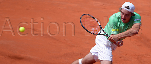 17.07.2013. Hamburg, Germany.  Jan-Lennard Struff of Germany returns the ball in the second round match against Spain's Lopez during the 2013 International German Open at Am Rothenbaum inHamburg,Germany, 17July 2013.