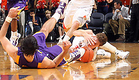 Jan. 2, 2011; Charlottesville, VA, USA; Virginia Cavaliers forward Will Sherrill (22) fights for the loose ball with LSU Tigers forward Garrett Green (3) during the game at the John Paul Jones Arena. Virginia won 64-50. Mandatory Credit: Andrew Shurtleff-