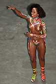 Rio de Janeiro, Brazil. Samba dancers during the carnival parade; woman practically naked with fluorescent paint and glitter.