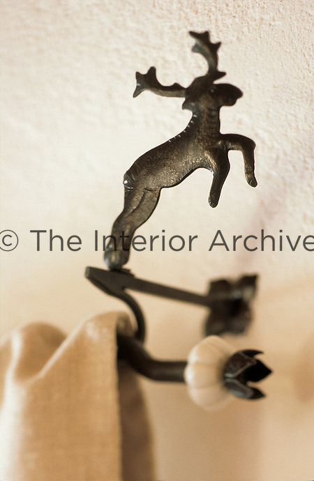 Detail of a curtain pole end featuring a delicate deer at the Hotel & Spa Rosa Aplina in the Dolomites