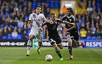 Erik Lamela of Tottenham Hotspur battles with Maksim Medvedev (Centre) of Qarabag FK & Badavi Guseynov of Qarabag FK during the UEFA Europa League match between Tottenham Hotspur and Qarabag FK at White Hart Lane, London, England on 17 September 2015. Photo by Andy Rowland.