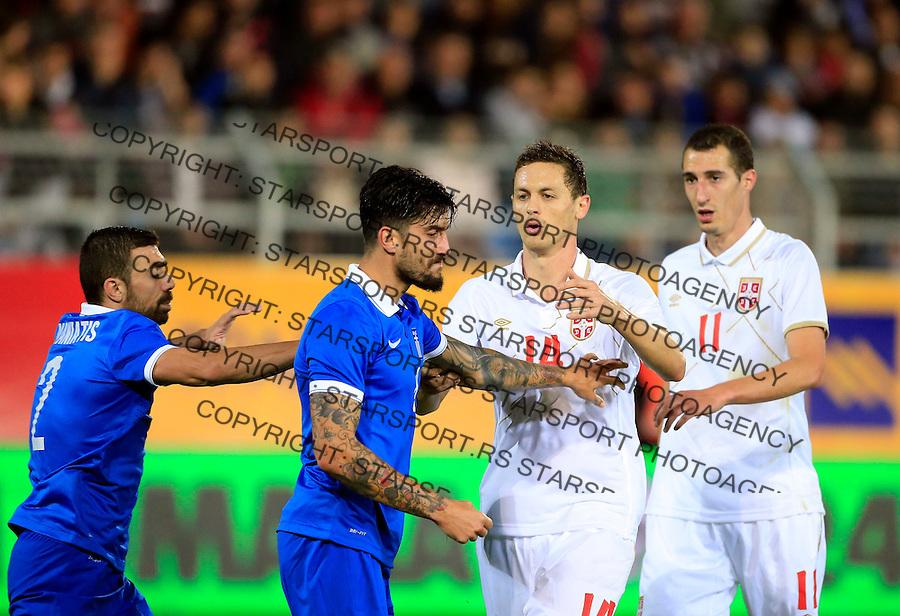 Fudbal<br /> Prijateljski mec-Friendly match<br /> Srbija v Grcka<br /> Panagiotis Kone (L) argues with the Nemanja Matic (C)<br /> Chania, 17.11.2014.<br /> foto: Srdjan Stevanovic/Starsportphoto &copy;