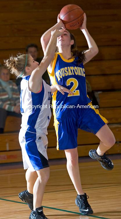 BURLINGTON, CT- 11 JAN 2008- 011108JT08-<br /> Lewis Mills' Alexis Veith fouls Housatonic's Hannah Savage during Friday's game at Lewis Mills. Mills won 58-47.<br /> Josalee Thrift / Republican-American