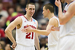 Wisconsin Badgers guards Josh Gasser (21) and Ben Brust (1) share a moment during  a regional semifinal NCAA college basketball tournament game against the Baylor Bears Thursday, March 27, 2014 in Anaheim, California. The Badgers won 69-52. (Photo by David Stluka)