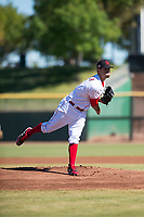 Scottsdale Scorpions starting pitcher Austin Orewiler (75), of the Cincinnati Reds organization, follows through on his delivery during an Arizona Fall League game against the Surprise Saguaros at Scottsdale Stadium on October 26, 2018 in Scottsdale, Arizona. Surprise defeated Scottsdale 3-1. (Zachary Lucy/Four Seam Images)