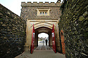 SPECIAL BREXIT FEA ON ANTRIM AND SDC TRAILERS FOR Arthur Beesley  - 9/1/2019 : A man walks tough the wall a gateway on the ancient wall of Antrim town centre, County Antrim, Northern Ireland.-  Photo/Paul McErlane