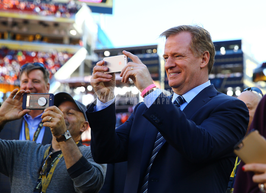 Feb 7, 2016; Santa Clara, CA, USA; NFL commissioner Roger Goodell takes a photo with an iPhone before Super Bowl 50 between the Carolina Panthers and the Denver Broncos at Levi's Stadium. Mandatory Credit: Mark J. Rebilas-USA TODAY Sports