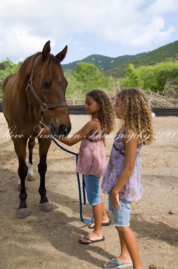 Girls with horse at Carolina Corral<br /> Coral Bay, St. John<br /> U.S.  Virgin Islands